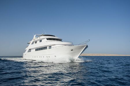Large luxury motor yacht under way sailing out at sea