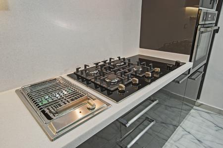 door knob: Interior design decor showing modern kitchen and appliances in luxury apartment showroom