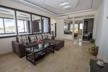 Living room lounge in luxury apartment show home showing interior