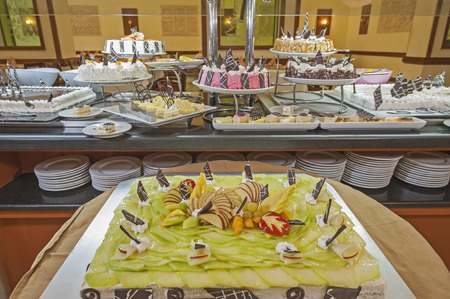 Selection of sweet desserts on display at a luxury hotel restaurant buffet bar Stock Photo