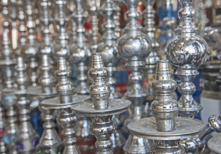 Closeup detail of shisha water pipes in row at an egyptian market stall Stock Photo
