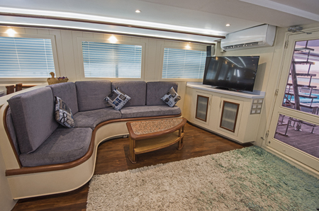 Interior design furnishing decor of the salon area in a large luxury motor yacht