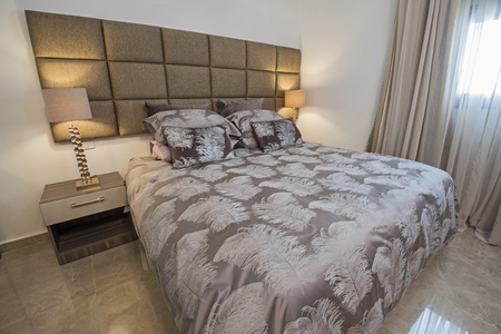 Interior design decor furnishing of luxury show home bedroom with furniture and double bed Archivio Fotografico