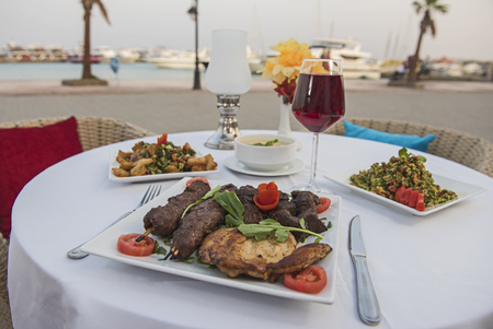 Luxury mixed grill meat meal in outdoor table setting at oriental restaurant