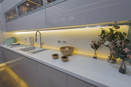 Interior design decor showing modern kitchen and cupboards in luxury apartment showroom