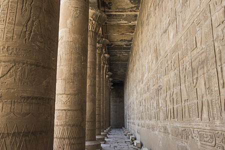 Hieroglypic carvings on wall and columns at the ancient egyptian temple of Horus in Edfu 스톡 콘텐츠