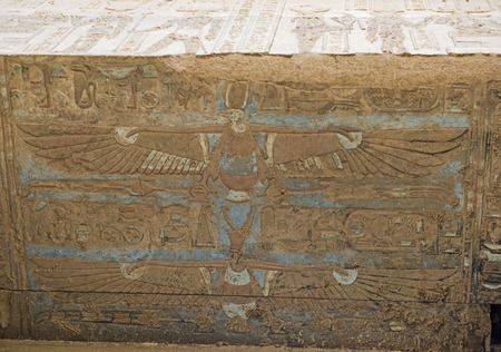 Painted hieroglypic carvings on wall at the ancient egyptian temple of Kom Ombo