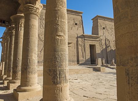 Hieroglypic carvings on wall and columns at the entrance to ancient egyptian Temple of Isis in Philae Island Aswan Archivio Fotografico