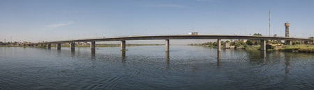 Panoramic view of large concrete road bridge spanning large wide nile river in Egypt at Kom Ombo Stock Photo