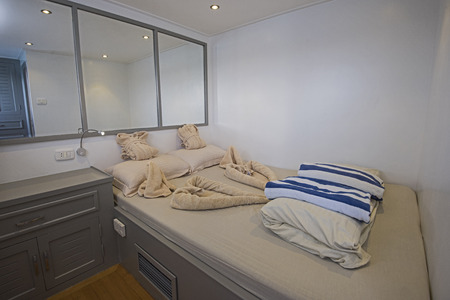 Double bed in cabin of a luxury private motor yacht