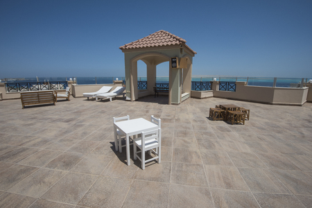 Large roof terrace patio area with seating and panoramic tropical sea view Imagens