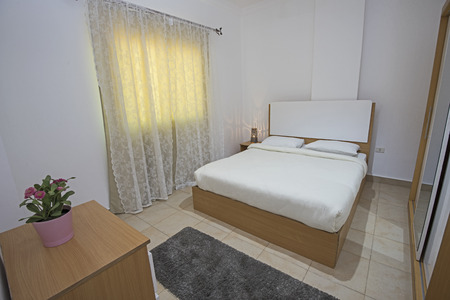Double bed in bedroom of luxury apartment showing interior design