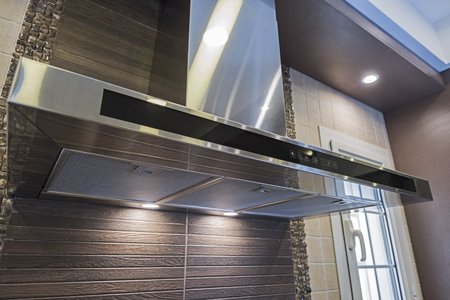 Interior design decor of modern kitchen showing cooker hood extractor fan appliance in luxury apartment showroom Imagens