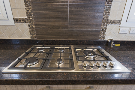 Interior design decor showing modern kitchen cooker hob appliance in luxury apartment showroom