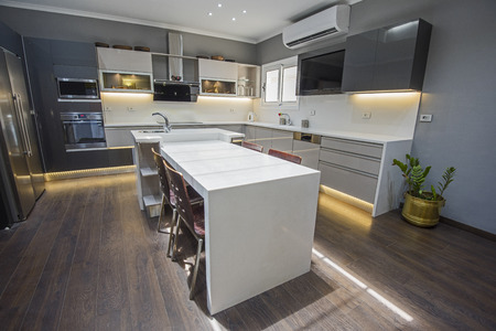 Interior design decor showing modern kitchen with cupboards in luxury apartment showroom Imagens