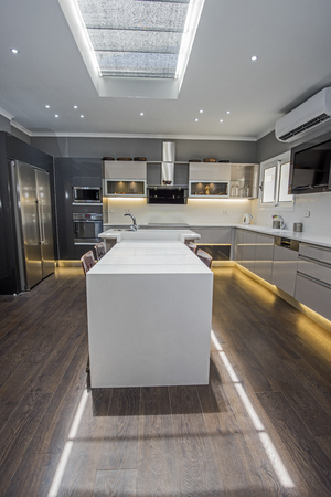 Interior design decor showing modern kitchen with cupboards in luxury apartment showroom Stock fotó