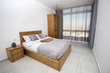 Interior design decor furnishing of luxury show home bedroom with furniture and double bed