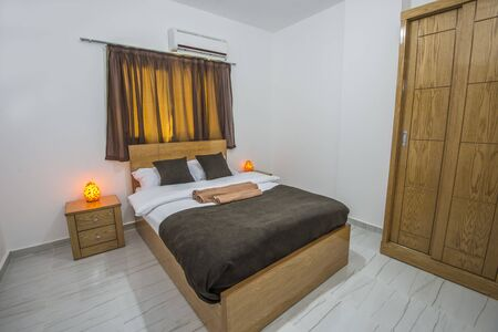 Interior design decor furnishing of luxury show home bedroom showing furniture and double bed
