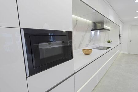 Interior design decor showing modern kitchen with cupboards in luxury apartment showroom 写真素材