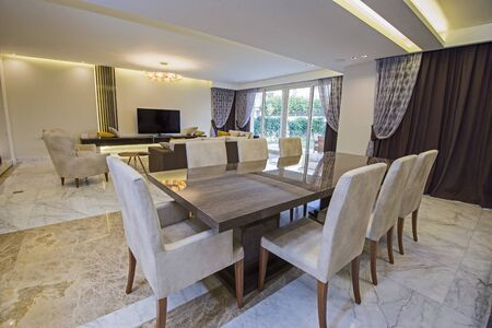 Living room lounge area in luxury apartment show home showing interior design decor furnishing with open plan dining area Stockfoto