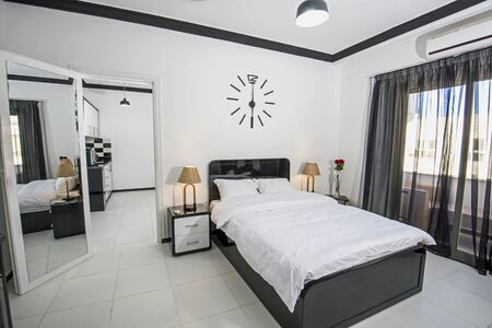 Interior design decor furnishing of luxury apartment bedroom in tropical resort with double bed and balcony