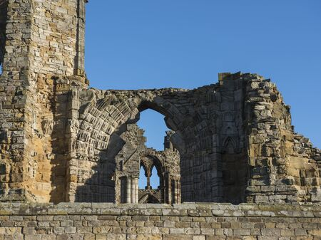 Remains of an ancient english abbey ruins showing details of gothic architecture