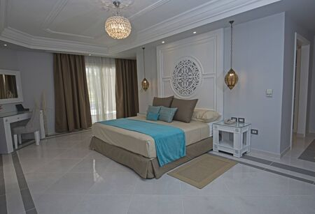 Double bed in master suite of a luxury hotel room