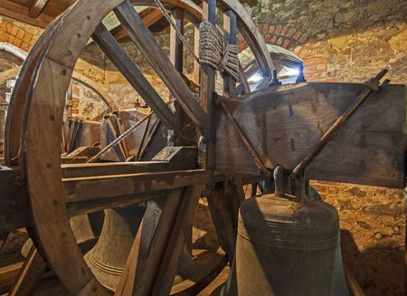 Traditional large old bells hanging in an english church tower from the middle ages