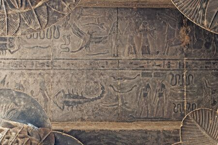 Egyptian hieroglyphic carvings on a wall at the Temple of Khnum in Esna