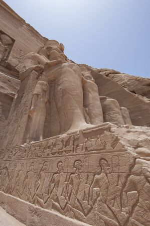 Exterior of ancient egyptian temple of Ramses II in Abu Simbel with giant statues and hieroglyphics