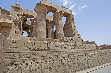 Hieroglypic carvings on wall at the ancient egyptian temple of Kom Ombo in Aswan