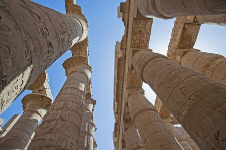 Hieroglypic carvings on columns at the ancient egyptian hypostyle hall of Karnak temple in Luxor Banco de Imagens