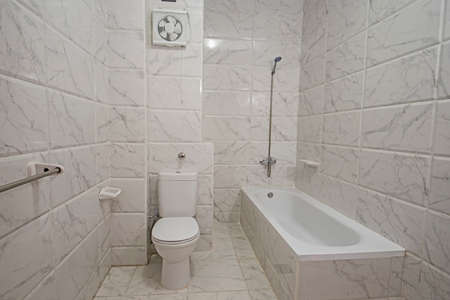 Interior design of a luxury show home bathroom with shower and bath