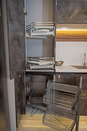 Interior design decor of kitchen in luxury apartment showing closeup detail of sliding carousel cupboard with shelves Banco de Imagens