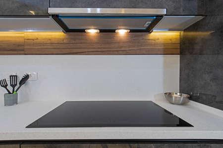 Interior design decor showing modern kitchen cooker hob in luxury apartment showroom