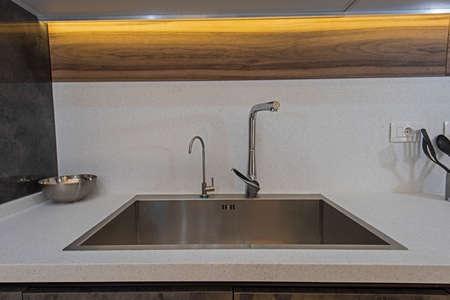 Interior design decor showing modern kitchen sink in luxury apartment showroom