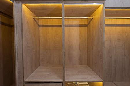Interior design decor furnishing of luxury show home bedroom showing walk in wooden wardrobe closet furniture Banco de Imagens