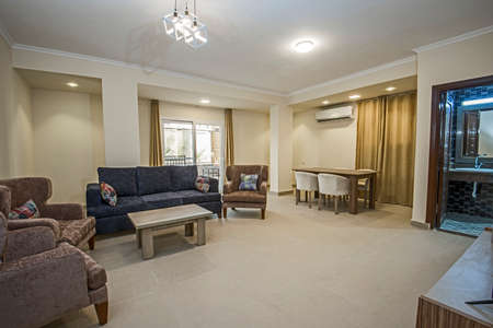 Living room lounge area in luxury apartment show home showing interior design decor furnishing with open plan dining area Banco de Imagens