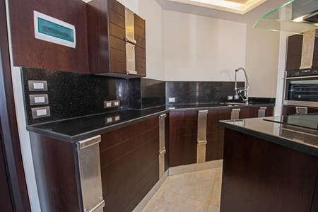 Interior design decor showing modern kitchen with cupboards in luxury apartment showroom