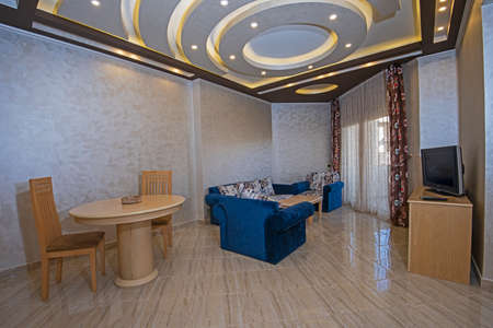 Living room lounge area in luxury apartment show home showing interior design decor furnishing with balcony