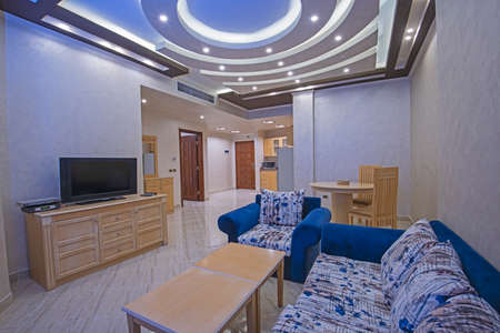 Living room lounge area in luxury apartment show home showing interior design decor furnishing with open plan design