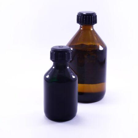 Blank Glass Medical Bottle Isolated on White Background. macro photo