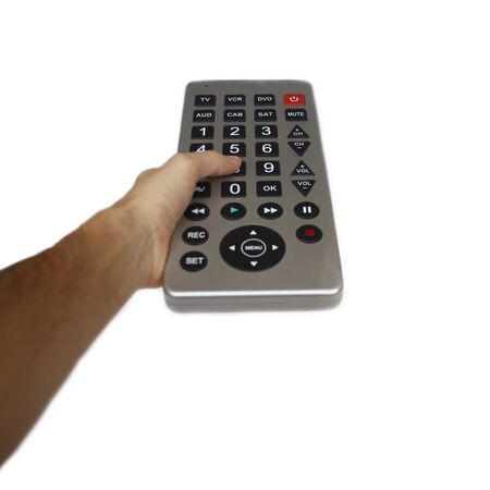 man hand holding tv conssole. Isolated on white background. thumb presses the button