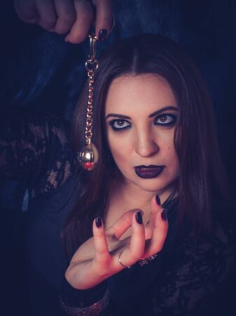 a fortune teller predicts the future using a magic ball, cards, and amulets. form for the designer.  The concept of magic and occultism. Divination. photomodels Stock Photo