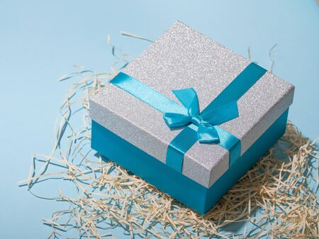 Present boxes on blue background greeting card holidays concept. empty space for text here