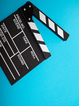 Movie production clapper board isolated on blue background. movie clapper isolated on blue. film making production. empty space for text
