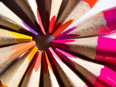 macro photography of colored pencils on a white background. back to school concept