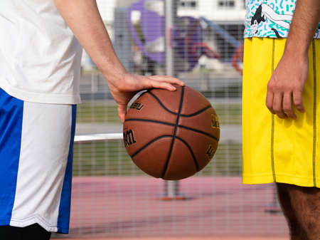 the opponents stand before the start of the game and look at each other. rivals in basketball Фото со стока