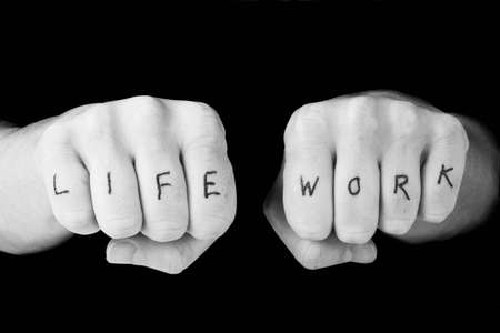Tattooed hands representing the work life balance Stock Photo - 4228002