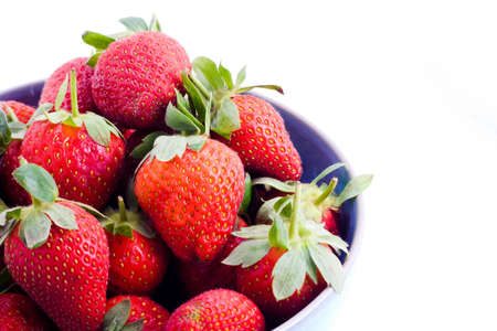A bowl of fresh strawberries with stems photo